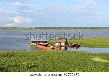 The river Amazon and boats, Peru - stock photo