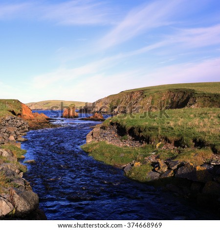 The river flowing out of Loch Spiggie, south Mainland, Shetland, Scotland, UK. - stock photo