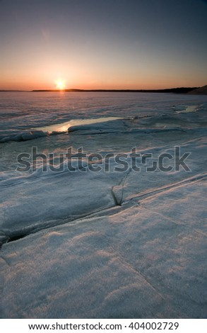 The river ice in ht sunset light