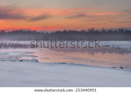 The river in the winter at sunset with fog - stock photo