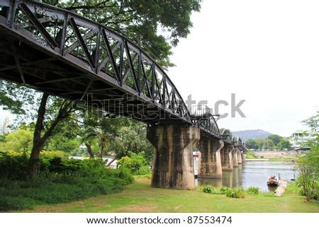 The River Kwai Bridge over the Kwai River, Kanchanaburi, Thailand - stock photo