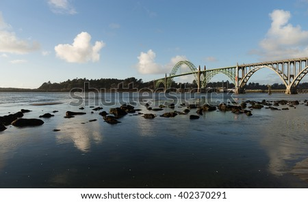 The river meets the Pacific Ocean under the Newport Bridge - stock photo