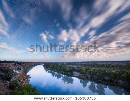 The River Murray lit up by the moon at midnight - stock photo