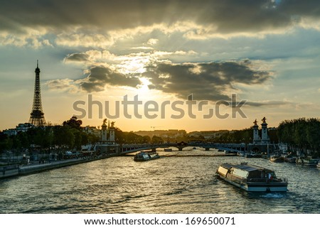 The River Seine with the Eiffel tower at sunset in Paris - stock photo
