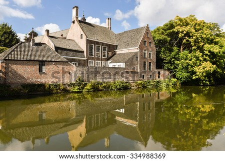 The river side of the small beguinage O.L.V. Ter Hooyen in Ghent, Belgium. - stock photo