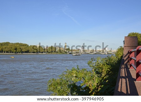 The River Thames at Battersea in London, England. Looking across to Chelsea.