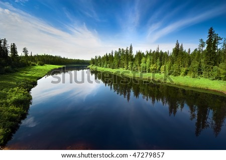 The river with a quiet current and clouds reflected in it, Sakha (Yakutia) Republic, Eastern Siberia, Russia - stock photo