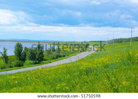 The road along the lake and clouds
