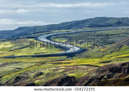 The road bend with tourist. Summer in Iceland 2016
