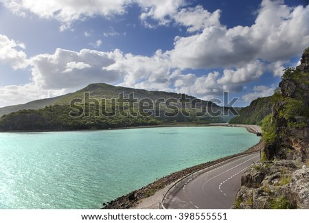 The road between hills at the lake. Mauritius. - stock photo