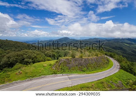 The road curves up Doi Inthanon
