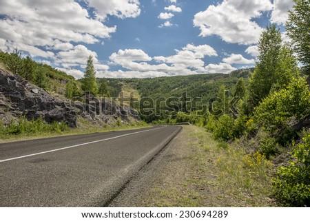 The road in the mountains of Bashkiria Ural, Russia. - stock photo