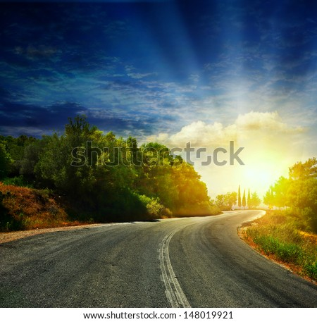 The road in the mountains to the sea - stock photo