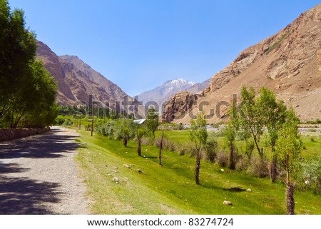 The road in valley of Pamirs. View of afghan mountains - stock photo