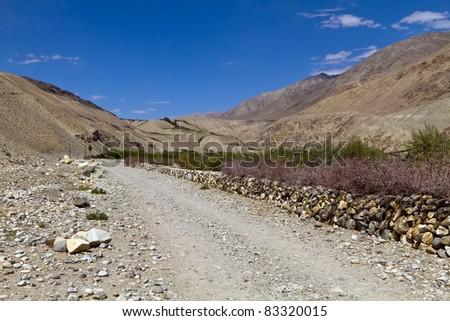 The road in valley of Pamirs. View of mountains