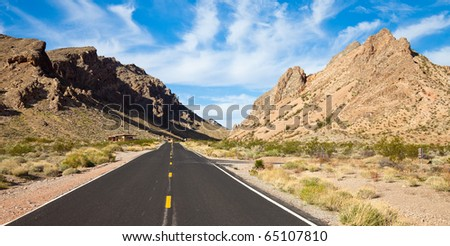The road into the Valley of Fire State Park, Nevada. - stock photo