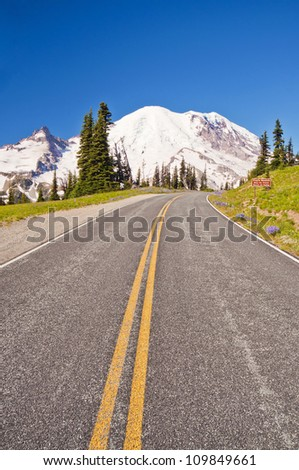 The Road Leading to Mt Rainier at Sunrise - stock photo