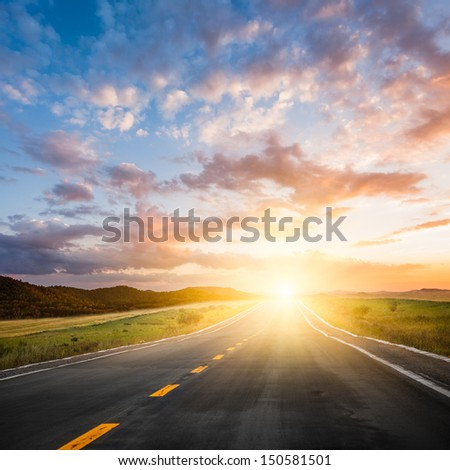 the road of the meadow. - stock photo