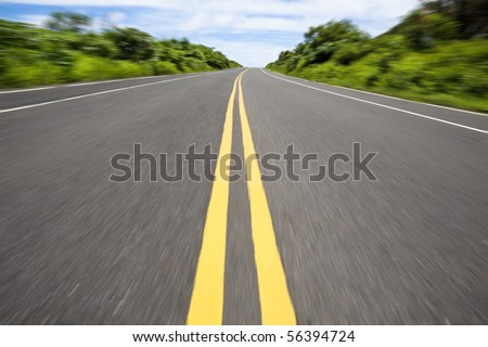 the road pass through the green jungle - stock photo