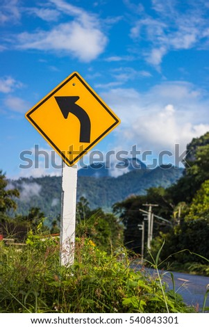 The Road sign left curve in Thailand