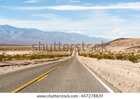 the road through the Death valley - stock photo