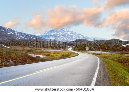 The road to mountains - stock photo