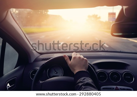 The road to success - a driver traveling on a road to the sun - stock photo