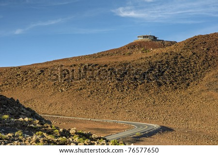 The road to the lookout at the 10,000 foot summit of the volcanic Mount Haleakala on Maui, Hawaii - stock photo