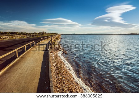 The road to the peninsula near the San Pedro del Pinatar. Region of Murcia. Spain - stock photo