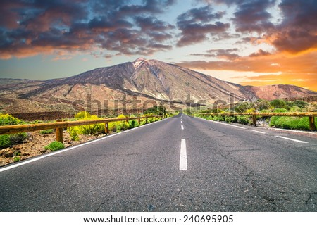 The road to the volcano Teide at sunset - stock photo