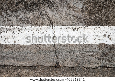 The road with white lines damaged. - stock photo