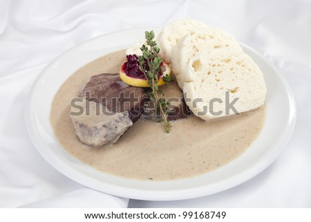 The roast sirloin w cream sauce and dumplings - stock photo