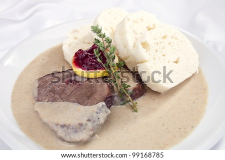 The roast sirloin w cream sauce and dumplings - stock photo