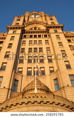 The Roayl Liver Buidling from a low angle. Pier Head, Liverpool, UK. - stock photo