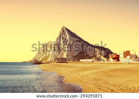 The Rock of Gibraltar at sunset, as seen from the beach of La Atunara, in La Linea de la Concepcion - stock photo