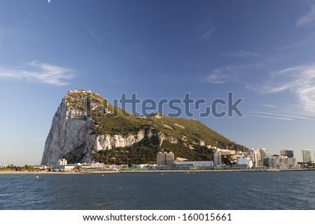 the rock of gibraltar in the late afternoon - stock photo