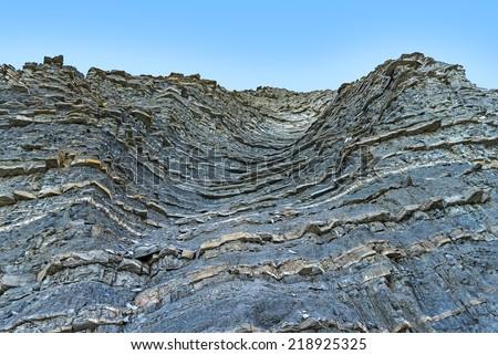 The rock  on the background of blue sky - stock photo