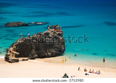 The rock on the left side of Waimea Beach - stock photo