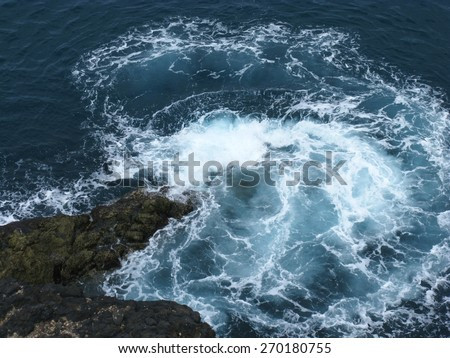 The rocks and the wave breakers of the Atlantic ocean at Puerto de la Pena on the island Fuerteventura one of the Canary islands belonging to Spain - stock photo