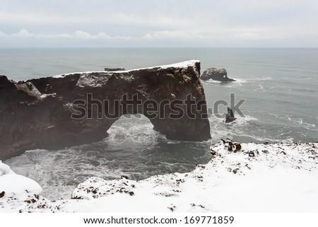 The rocks at Dyrholaey near Vik - stock photo