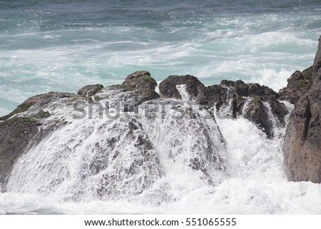 the rocks in the waves