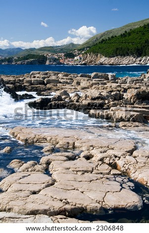 The Rocks section on the southern tip of Lokrum Island. Dubrovnik is visible in the background. - stock photo