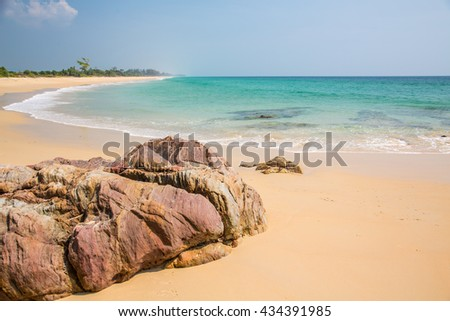 The rocky beach on the island Southern Thailand. - stock photo