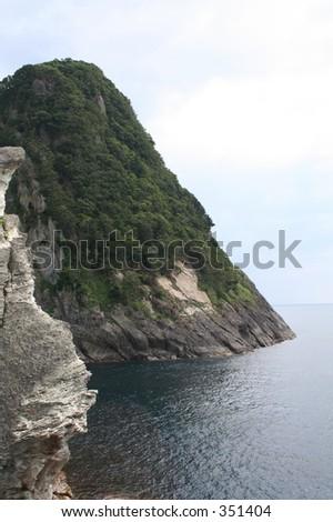 The rocky coast of the Izu Peninsula, South of Tokyo, Japan - stock photo