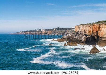 The rocky coastline of Cascais is famous for the cave named, The jaws of the devil or The gates of hell, Portugal. - stock photo