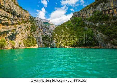 The rocky slopes of canyon Verdon descend into azure water of the river. Mercantour National Park, Provence - stock photo
