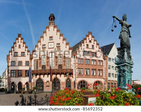 The Roemer at Roemerberg, Frankfurt's Town Hall and center of the Old Town. Statue of Lady Justice (Justitia) in the foreground. - stock photo