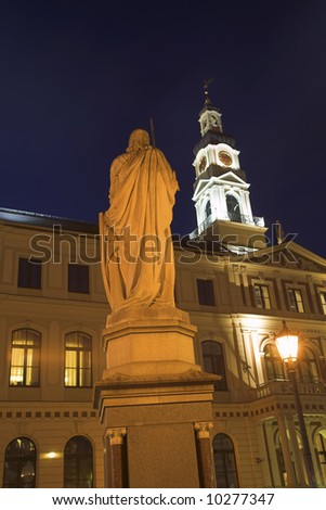 The Roland Statue And Town Hall, Old Town Square, Riga, Latvia - stock photo