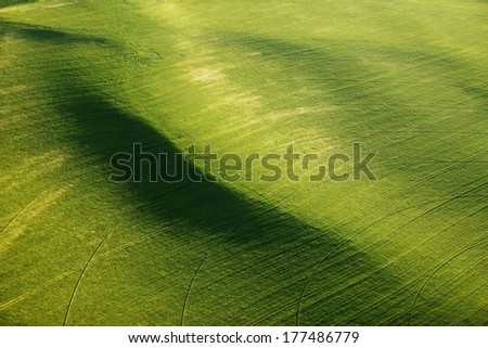 The rolling hills of green farmland - stock photo