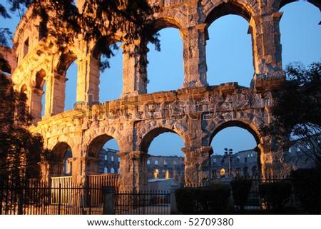 The Roman Amphitheater of pula, Croatia at night. - stock photo